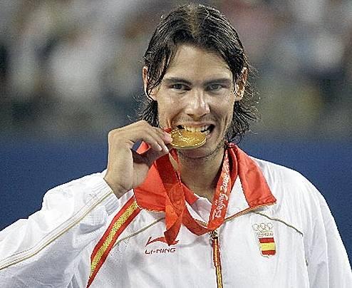 メダルを最初に噛んだのはダンカン・アームストロング